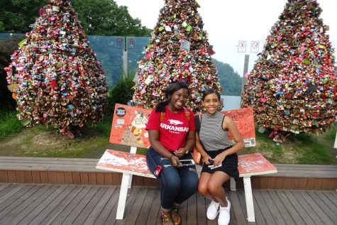 Jada Brunson- a Central alumn- and senior Jada Henry sit in front of the Locks of Love at the base of Seoul Tower.