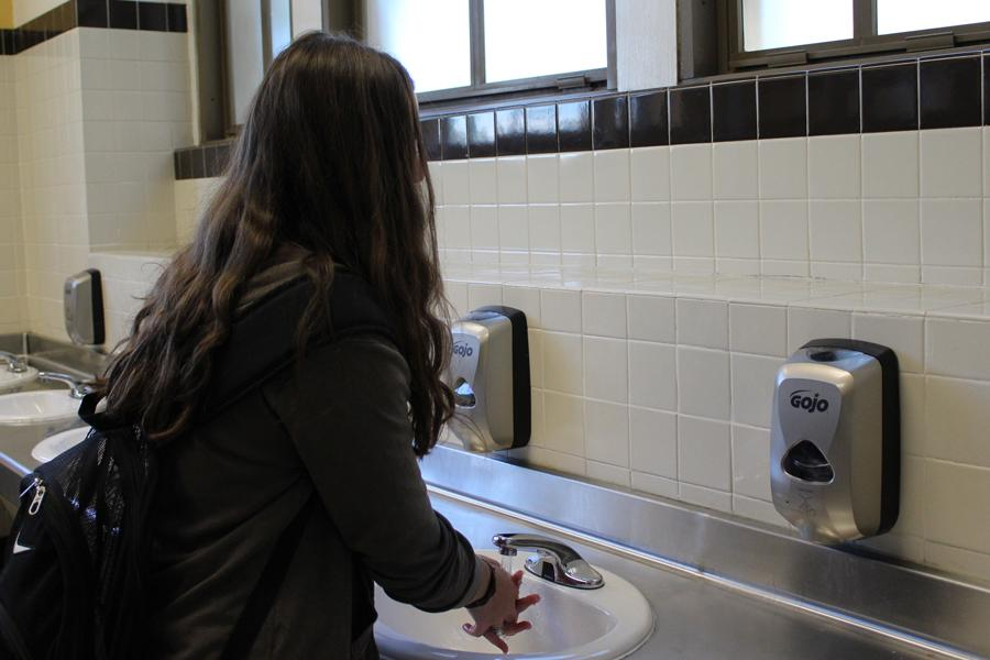 In the newly renovated second floor girl's bathroom, sophomore Hayden Wickliffe washes her hands using the automatic soap dispensers in between classes. The soap dispensers were included in the bathroom improvements that occurred during summer of 2016.