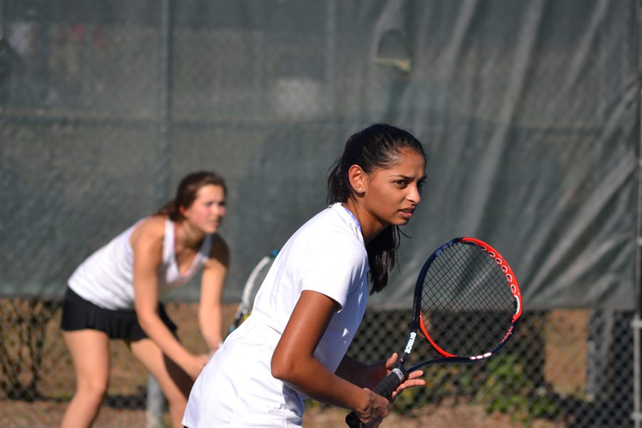 Seniors Sarah Sutter (left) and Lina Patel (right) play doubles during their match against Episcopal on Thursday, September 29.