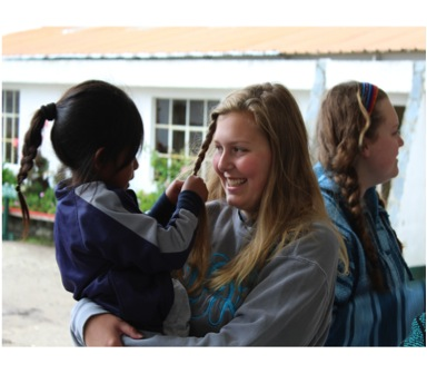 Junior Lauren Berry enjoys getting to know a young girl after a long day of aiding in dental work.