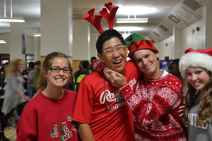 (Left to right) Sophomores Fern Bailey, Jae Kim, Robert Pierce, and Lauren Correll dress up on Holiday Day of Spirit week in the cafeteria on Thursday, Oct. 20.