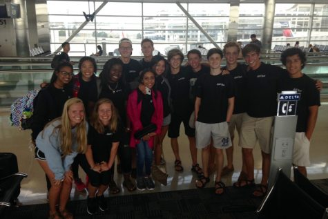 American students smile in the Detroit Airport before heading to South Korea.