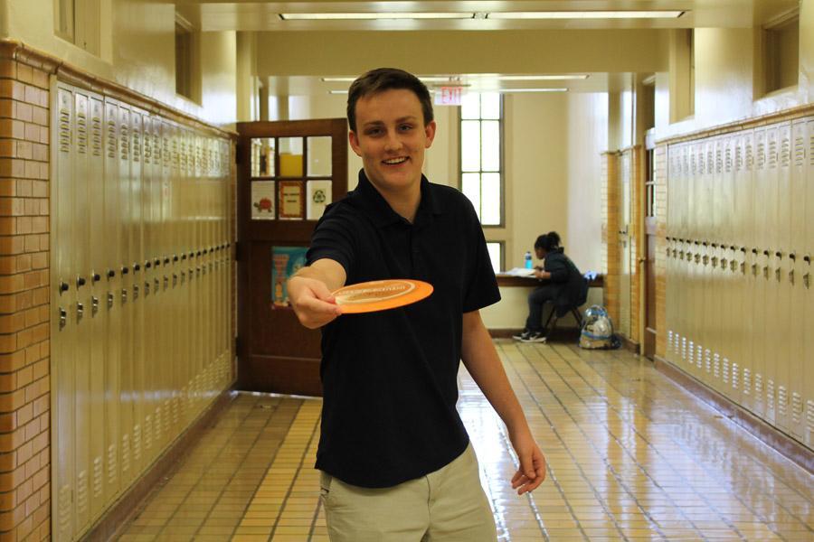 Junior Henry Allen shows off his stroke in the hallway.