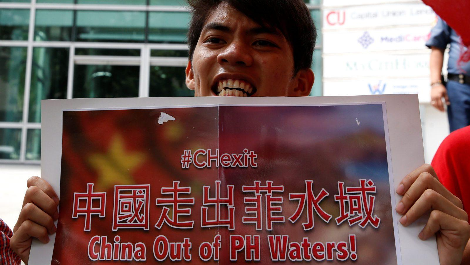 A Vietnamese man joins forces with protesters in the Philippines against Chinese holdings of the South China Sea.