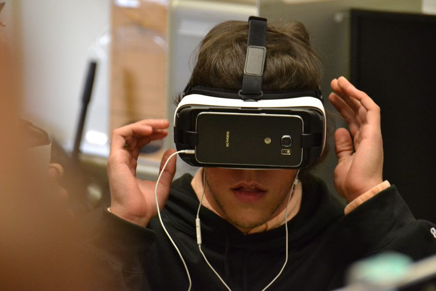Senior Zach McCormack experiences a new world through a virtual reality headset in the computer science room on Thursday, Jan. 5. The headset was one of 500 donated to Arkansas high schools by Facebook to promote computer programming interest among young people in the state.