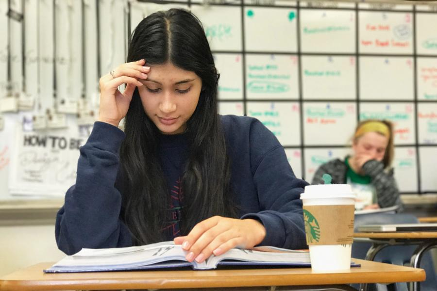 Senior Mira Cary uses her free time in class efficiently, sipping Starbucks while studying for her AP Environmental Science third nine weeks exam. At this midterm point in the semester, seniors are bogged down with multiple tests and large papers due in AP English Literature, all while trying to fight senioritis. While prom and the glamor of spring break are visible on the horizon, cramming is still alive and well at Central.