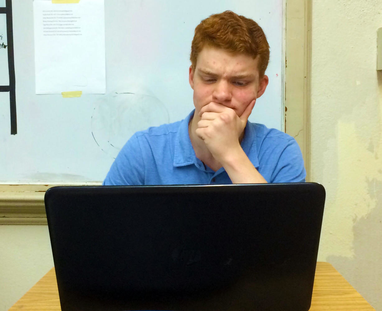 Senior Sam Pierce struggles with logging into his eSchool account. Many students have encountered an