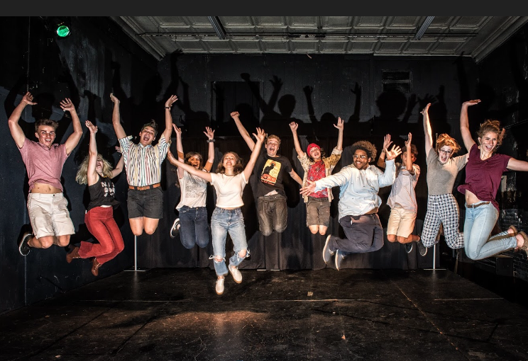 The Armadillo Rodeo cast jumps for joy at their new season, which begins with their first show on October 27. They will be performing at the Public Theatre downtown on 616 Center St. (Photo courtesy of Ollie Burrow)