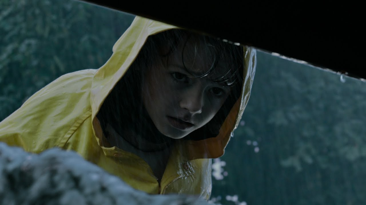 Georgie Denbrough peeks into the sewer where his paper boat, made by his brother Bill, has fallen. Moments later it is returned to him by Pennywise the clown, other wise known as 'It'. Georgie's death is the first of the film and kick starts the plotline. (Photo courtesy of Google Images)