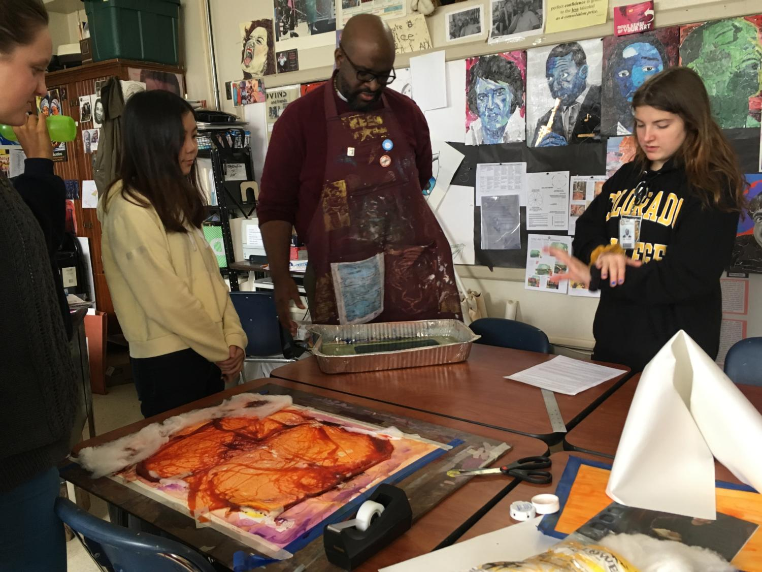 During his AP 2D Design class, Deloney shows his students new, creative ways to create unique compositions for their AP Portfolios. (photo by Sydney Gastman)