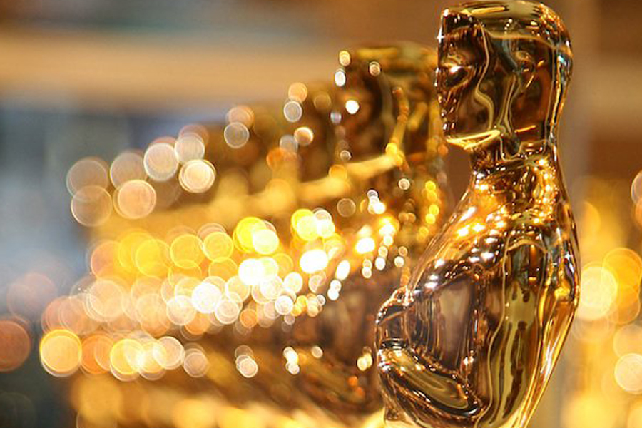 Oscar statues line up ready to be awarded to winners. (Photo courtesy of The Wrap, AMPAS)