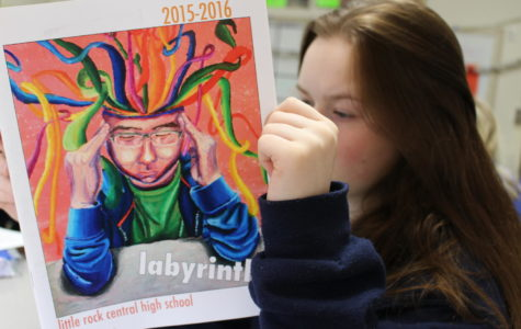 Senior Julia Greer reads an older edition of the Labyrinth as she eagerly awaits the release of the 2017-2018 edition. (Photo by Fran Delacey)