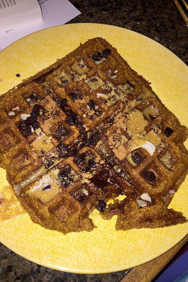 This waffle, topped with coconut flakes, cacao nibs, raisins, and peanut butter mixed with pure maple syrup, is sure to satisfy your sweet fall cravings. (photo by Sydney Gastman)