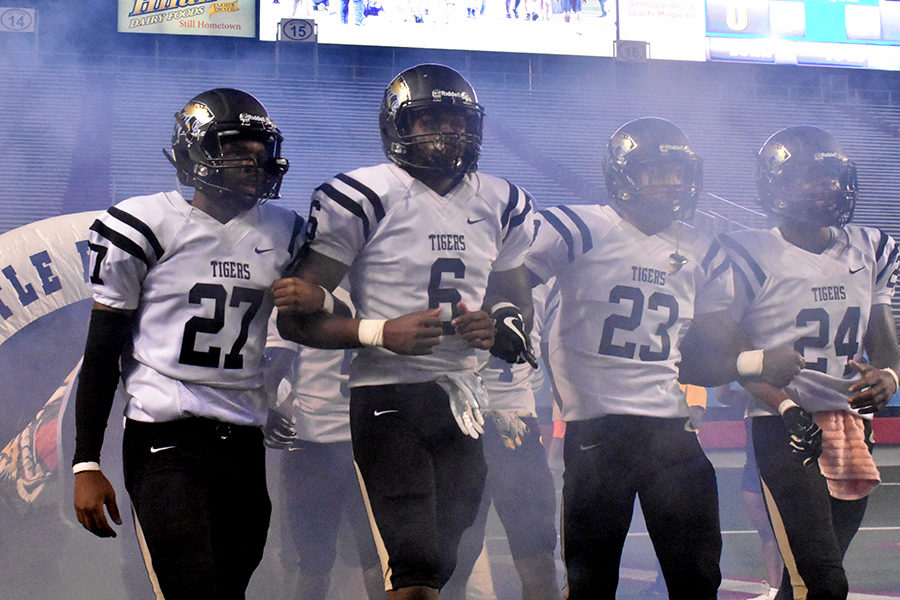 Taking the field for the first time of the season at War Memorial, walking arm in arm (Left) Avonte Harris (Left Center) Dejaun Brewer (Right Center) Jonathan Jones (Right) Keylin Holloway. (photo by Parker Gunn)