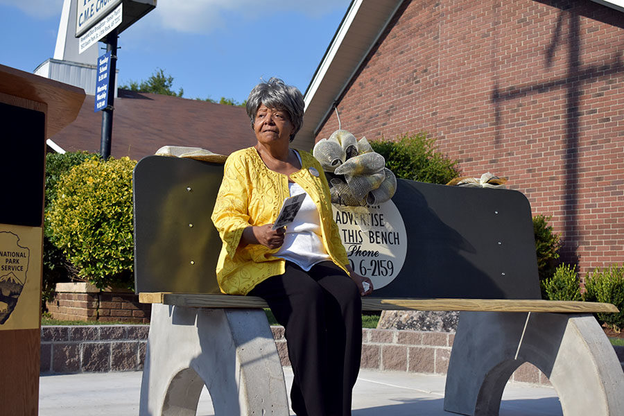 Elizabeth Eckford returns back to the bench filled with history but this time around, instead of words filled with hatred, it is replaced with respect and commemoration for all of the struggles and hardships that she was faced with years before. (photo by Parker Gunn)