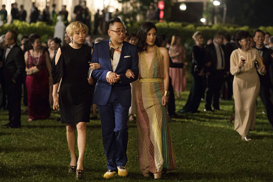(From left) Awkwafina, Nico Santos, and Constance Wu walk arm in arm at a party at Wu's characters boyfriend's grandma's house, setting the scene for the rest of the movie. (photo courtesy of the Inquirer)