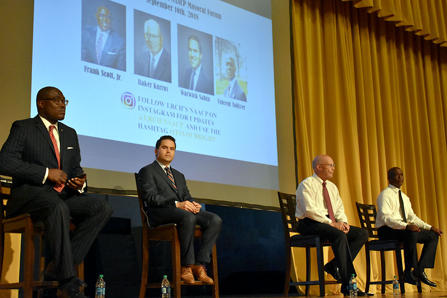 The four mayoral candidates (from left) Frank Scott Jr., Warwick Sabin, Baker Kurrus, and Vincent Tolliver share their platform ideas in the mayoral forum for the NAACP. (photo by Claire Hiegel)