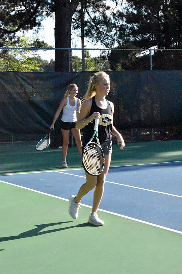 Seniors+Mary+Kathryn+Roberts+and+Abby+Adkins+compete+in+a+doubles+match+against+Mount+St.+Mary%E2%80%99s+Tuesday+Aug.+25+at+Rebsman+Park.+%28photo+by+Parker+Gunn%29