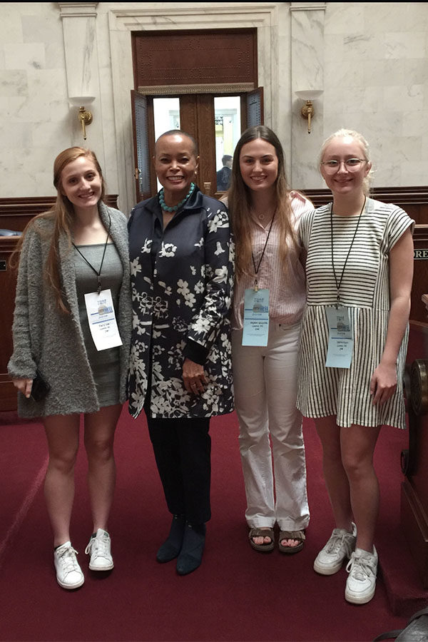 (From Left) Senior President Emily Low, Senator Joyce Elliott, Senior President Hayden Wickliffe, and Sophie Ryall meet at the Young Democrats Conference to hear local and state politicians speak at the State Capital. (photo by Emily Low)