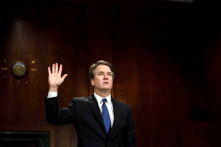 Supreme Court nominee Brett Kavanaugh is sworn in before the Senate Judiciary Committee in Washington, D.C., on September 27, 2018. He testified before the committee to defend himself in the face of allegations of sexual assault from Dr. Christine Blasey Ford. (photo Courtesy of Erin Schaff/UPI)