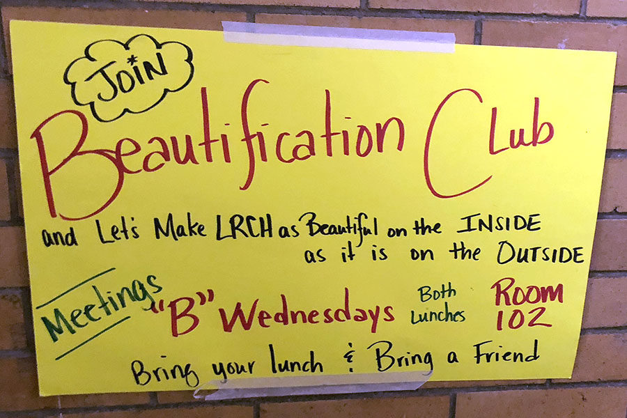 Beautifying Central's Walls. Members of the Beautification club work to enhance Central's appearance with decoration and themes. Posters appear throughout Central to recruit help. (photo by Mollygrace Harrell)