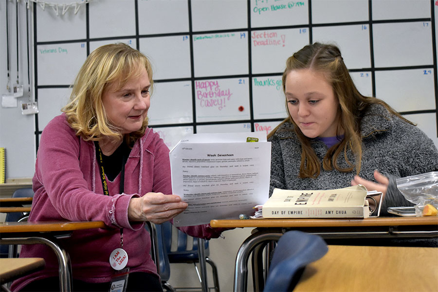 Tiger staff advisor Carol Holiman interacts with her newspaper staff. Students work on stories as Holiman asks about their progress in their work. (photo by Jakob Mueller)