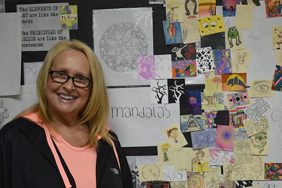 Intro to Art teacher Karen Terry displays her students' artwork in the classroom. (photo by Claire Hiegel)
