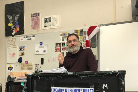 Adam Kirby teaches his AP comparative government class with a smile, proud of how much his students know about the world. Kirby sets his students up for success when going into the final exams. (photo by Emily Low)