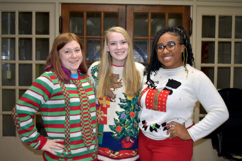 (Left to Right) senior Kiera Boop, Kennedy Kasten, and Briania Fleming take time out of AP Lit to show of their bright and colorful ugly sweaters. (photo by Parker Gunn)