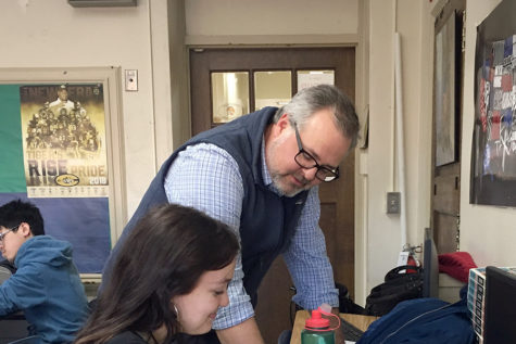 Matthew Dean helps Junior Eleanor Burks with analyzing historical documents. 	Matthew Dean first came to Central as a student, and now he teaches APUSH and Civics here. (photo by Lily Ryall)