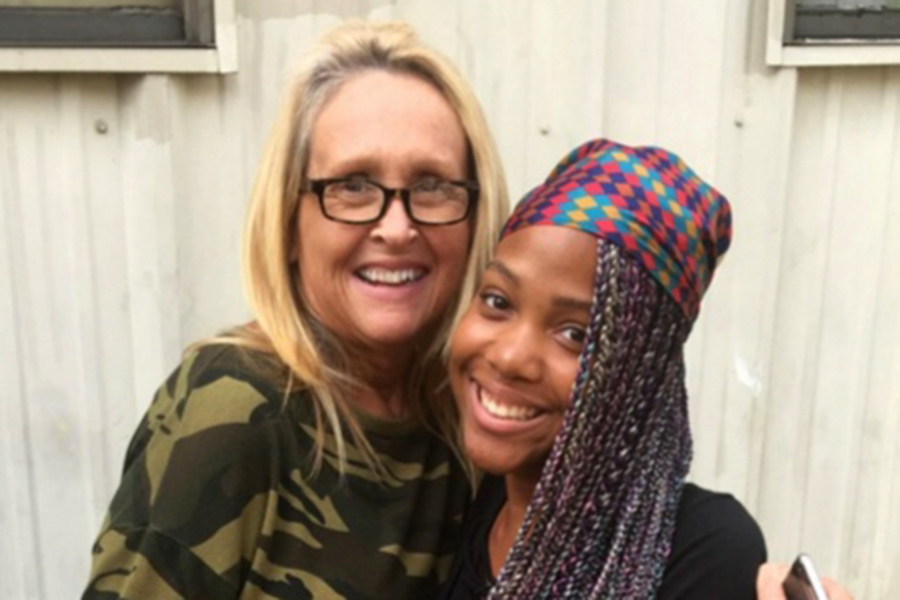 Art teacher Karen Terry and senior Zania Williams bond inside and outside the classroom. (photo by Claire Hiegel)