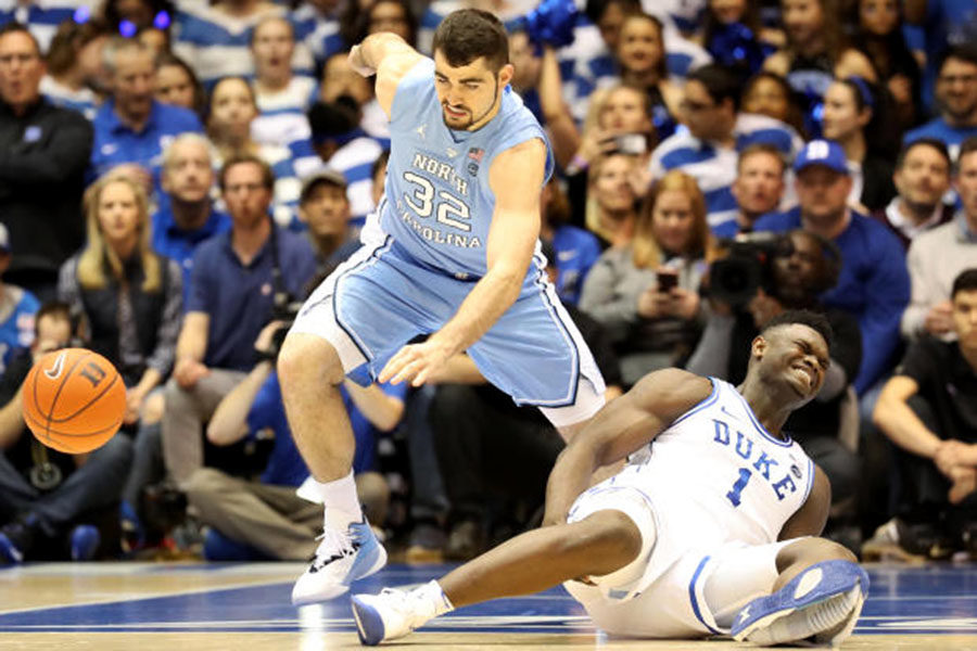 Duke forward Zion Williamson busts out of his shoe in the first minute of a game against the University of North Carolina Tar Heels on Feb. 20, 2019. Duke played without him the rest of the game and lost 72-88. Duke is 3-2 in the following games in which Williamson has not played. (Photo by Streeter Lecka/Getty Images)