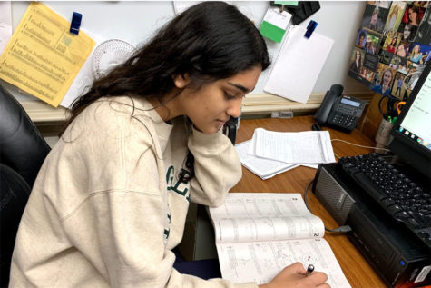 Junior Sarah Thomas studies for the ACT at least once a week. Sarah credits her score increases to her strong study habits.  (photo by Lily Ryall)