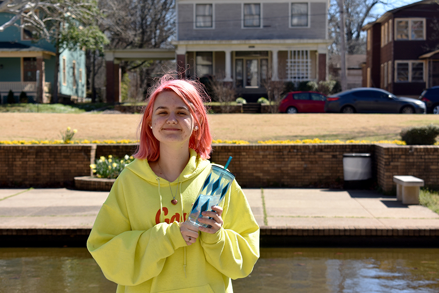 Lucy Lyon brings her reusable cup to school everyday to avoid single-use cups and bottles. (photo by Claire Hiegel)