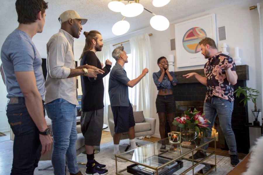 Antoni Poroski, Karamo Brown, Jonathan Van Ness, Tan France, and Bobbi Berk show Jess Gilbeaux around her newly designed home. The 22 year old is the first lesbian featured in the show. Before the Fab Five showed up, Gilbeaux was forced to dropout of college and get a job when her parents kicked her out after she was outed to them. However, a Kickstarter fundraiser was launched and raised over $100,000 for her to return to college. (photo courtesy of NBC News)