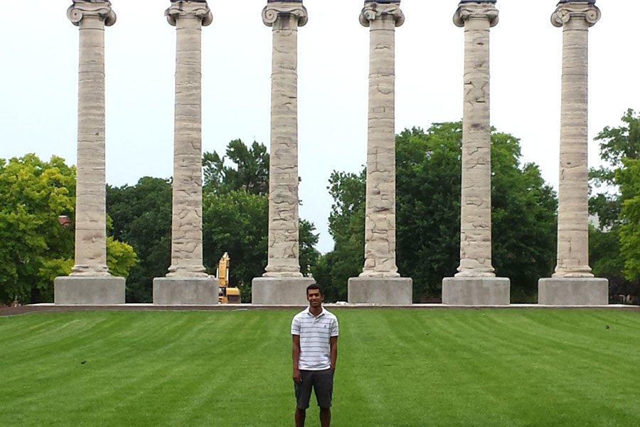 Tiger+staff+alumni+Pate+McCuien+stands+in+front+of+the+columns+at+Mizzou+where+he+is+pursuing+a+journalism+career.+%28photo+courtesy+of+Amber+McCuien%29