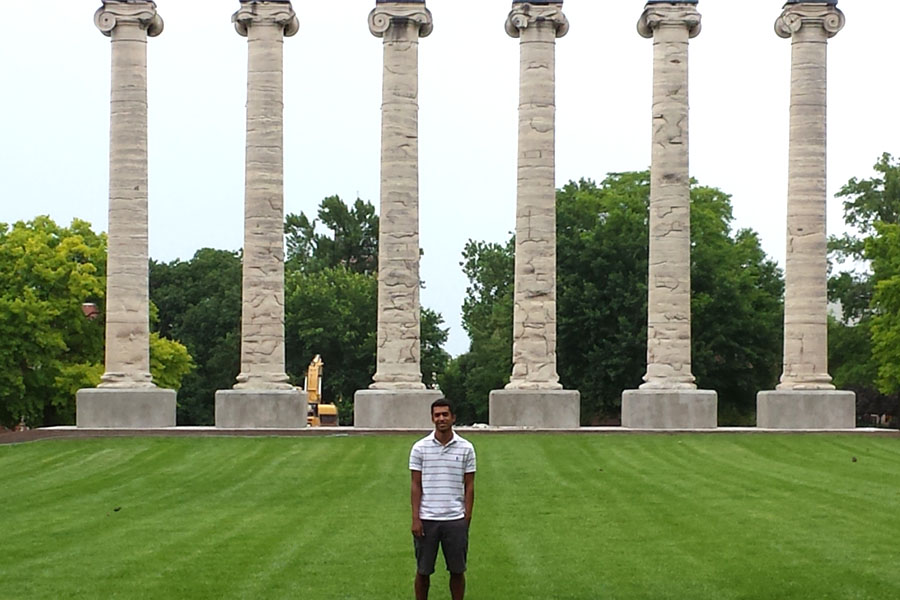 Tiger staff alumni Pate McCuien stands in front of the columns at Mizzou where he is pursuing a journalism career. (photo courtesy of Amber McCuien)