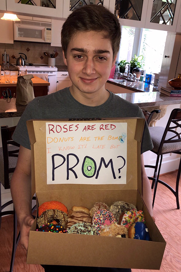 """Senior Drew Clark """"promposes"""" to his date, a tradition that's been popularized in recent years. (photo courtesy of Drew Clark)"""