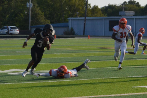 Senior Antoine Westbrook dodges a tackle from Hall Warrior and looks to score (photo by Annie Fortune).