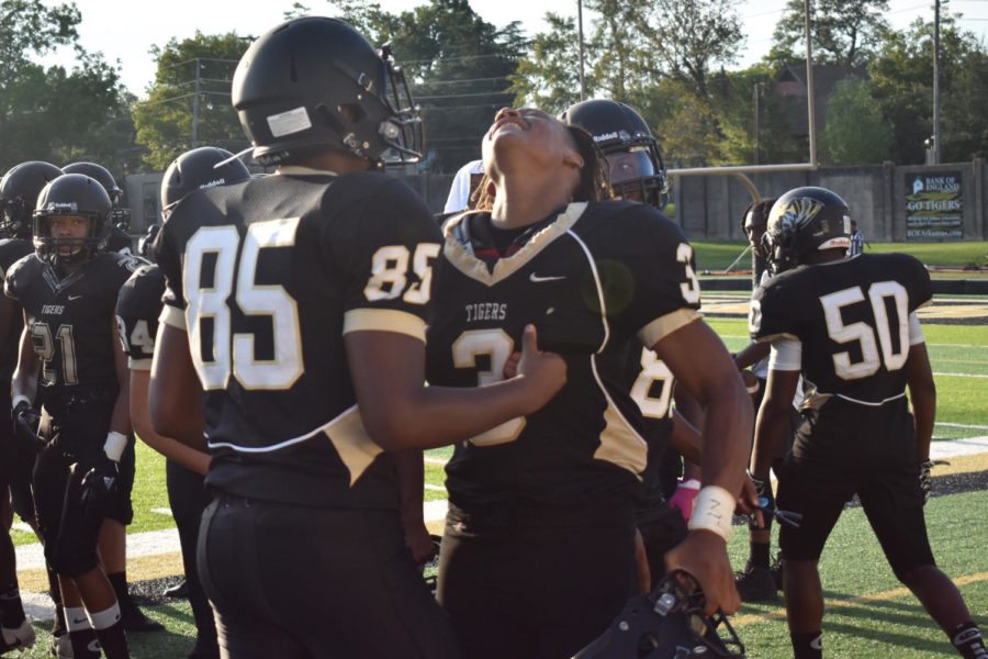 Number 85 and Westbrook celebrate after scoring a touchdown against Hall Warriors.