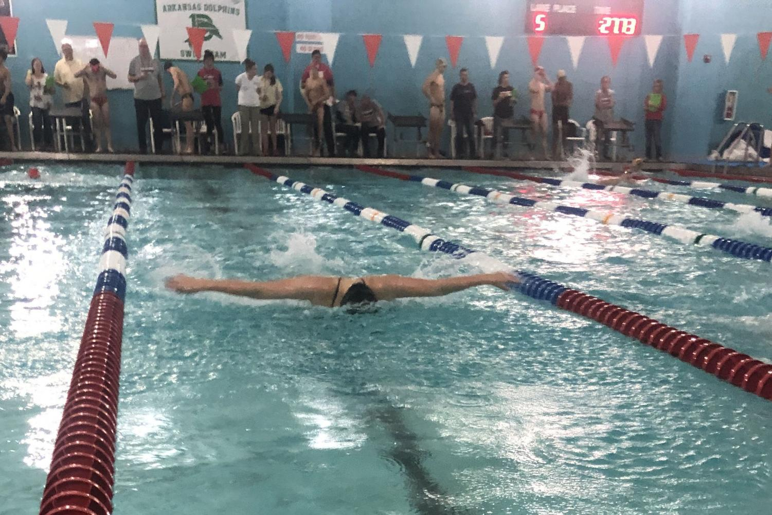 Senior Gabrielle Jenkins 'flys' down the pool, placing second at the Cat Fight.