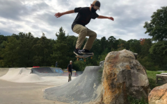 "Freshman Hugh Jarvis Ollies down the ""Rock Drop"" at Kanis Park."
