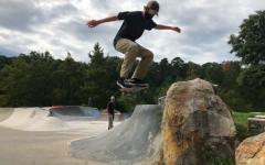 "Freshman Hugh Jarvis Ollies down the ""Rock Drop"" at Kanis Park."