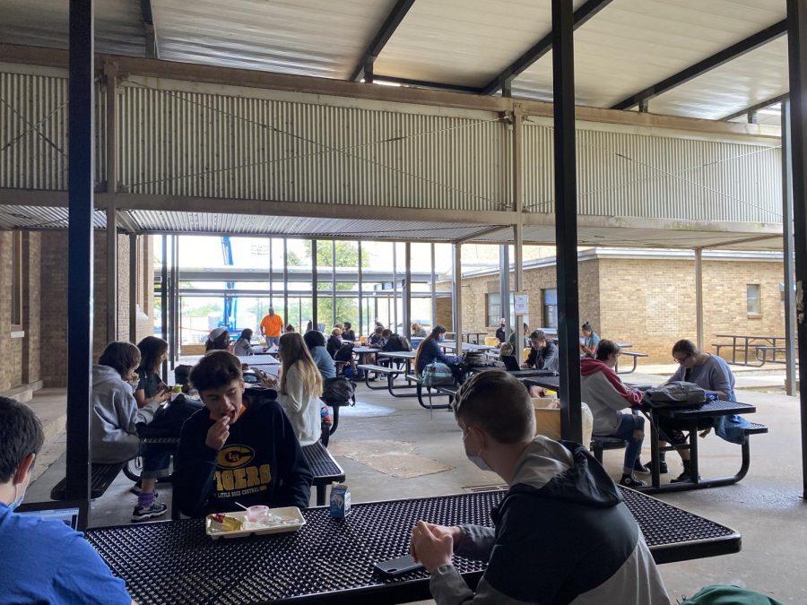 Students eating lunch on the patio must sit diagonally from each other, with both seats empty next to them as well as the one in front of them.