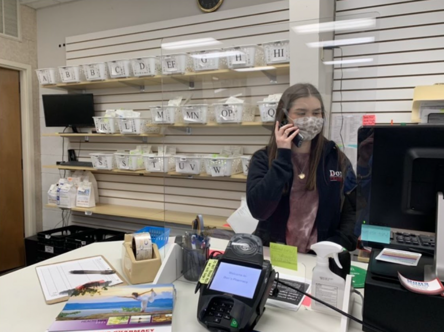 Olivia Hayden answers a call from a customer at Don's Pharmacy in Little Rock.