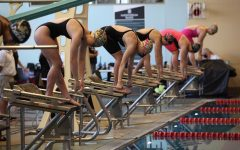 """Sophomore Kathleen Claycomb (lane 4) and Junior Alexa Coughlan (lane 5) go head to head in the 200 Individual Medley. """"My main goal was just to score points for my team,"""" Claycomb said."""