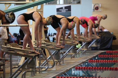 "Sophomore Kathleen Claycomb (lane 4) and Junior Alexa Coughlan (lane 5) go head to head in the 200 Individual Medley. ""My main goal was just to score points for my team,"" Claycomb said."