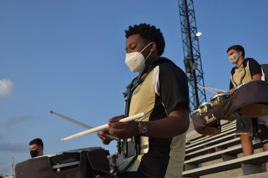 The+show+must+go+on%21+Drumline+plays+audiences+while+maintaining+social+distance+with+masks.++Senior+Quincy+Haynes+%28right%29+Junior+Christian+Anderson+%28Center%29+and+Sophomore+Steve+Abochale.++%0A