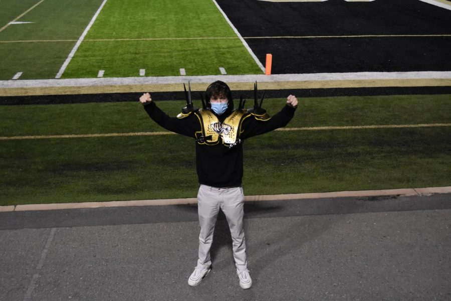 Senior Swag.  Senior Andrew Carvill is all dressed up and masked up with Tiger pride for the Central Football Game.
