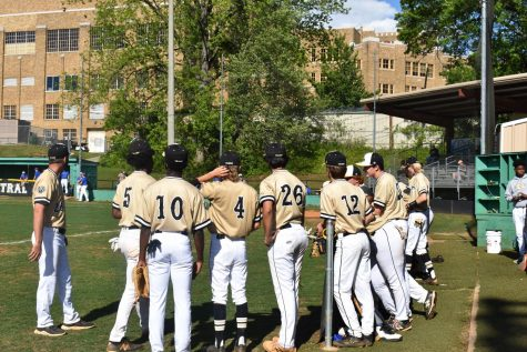 The Tigers huddle around in anticipation as they wait to take the field before the game.  Photo by Lillie Dunagan
